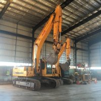 14t & 30t excavators parked in shed for servicing