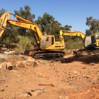 14t & 30t excavators trenchinf through rock in Dampier